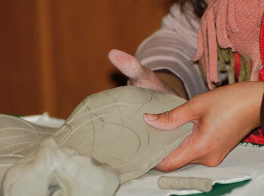 Atamayka uses clay as canvas for drawings of faces